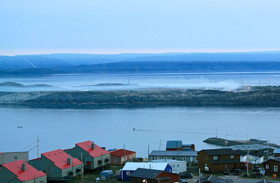 Smoke from Iqaluit's dump fire across Koojesse Inlet from the city's southern neighbourhoods, streams southward just after sunset Aug. 1. (PHOTO BY PETER VARGA)