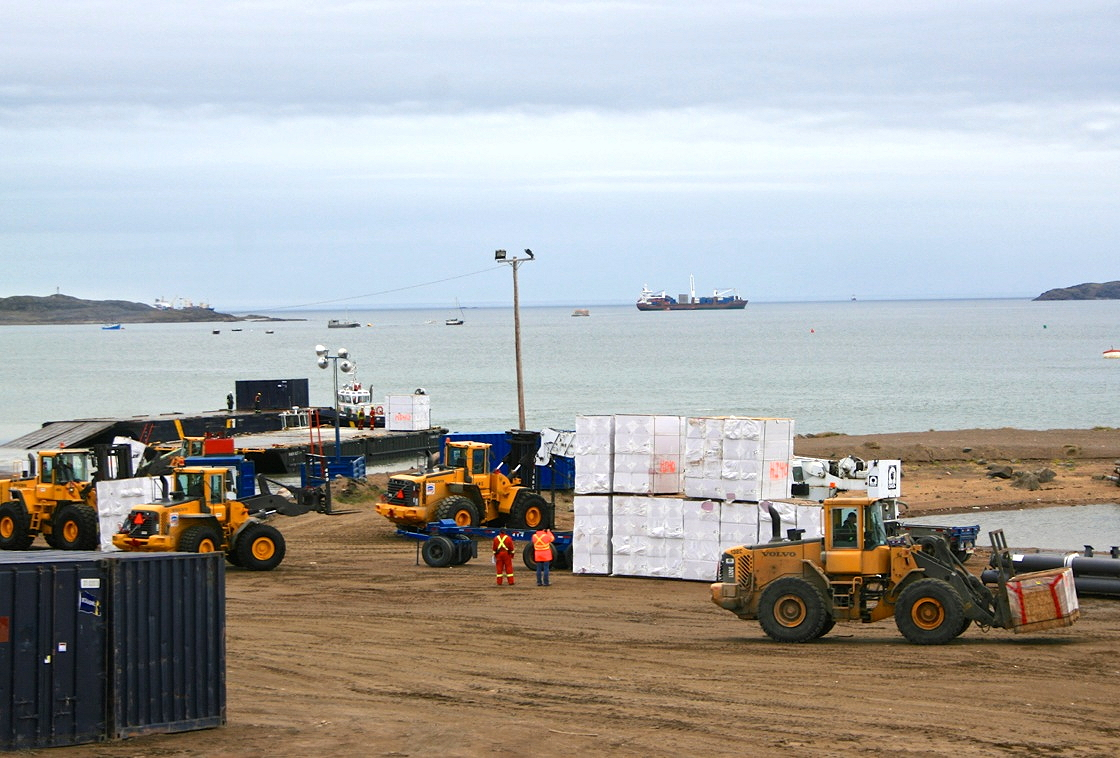 Once Iqaluit's deep-sea port opens in 2021, the city's beachfront will no longer feature crowded scrambles on sand like this one, from the sealift season of 2014. (PHOTO BY PETER VARGA)