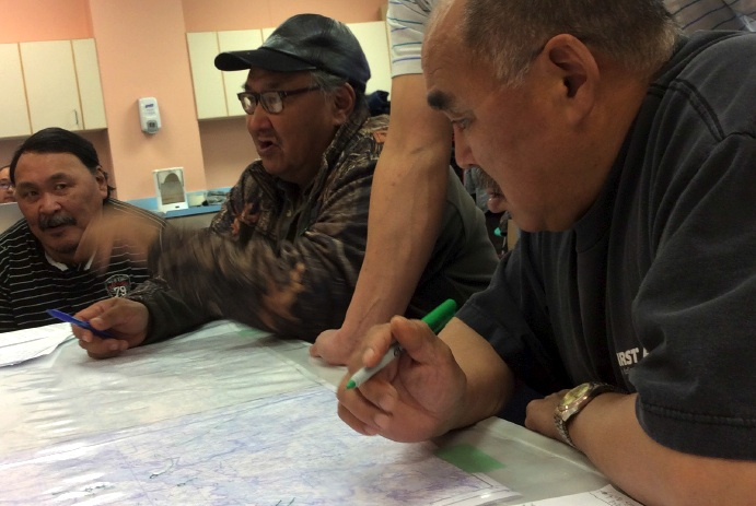 In Arviat, participants in a community-based research study on low-impact shipping corridors discuss where the corridors should run, in this photo pulled from the recently released report from the University of Ottawa.