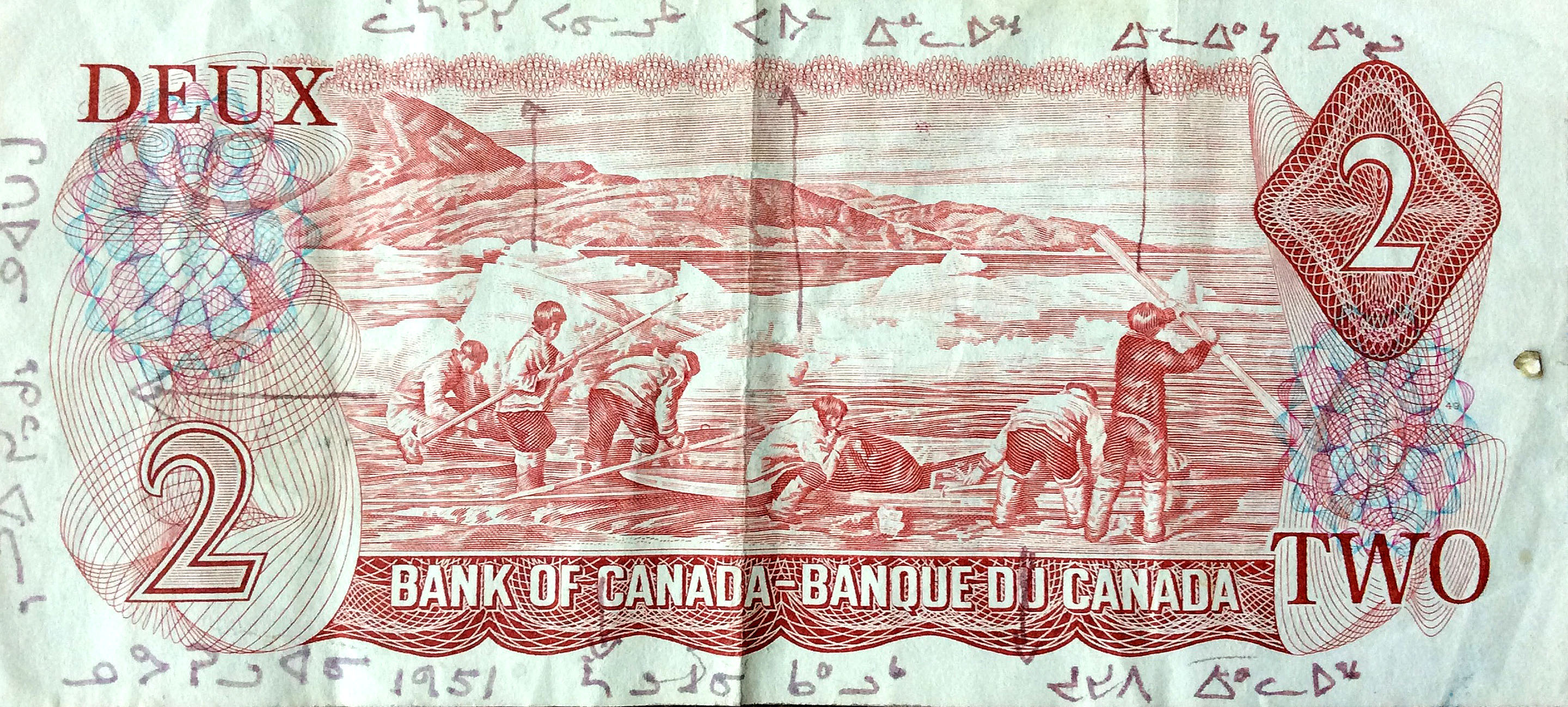 Here's the Inuit two-dollar bill that circulated between 1975 and 1996, based on a photograph that the late Doug Wilkinson took in 1951, with the names of the six men written on it by the late Leah Idlout: From left to right: Gideon Qitsualik, crouched and working on a kayak; Lazarus Paniluk, holding a harpoon; Solomon Kalluk, bent over a kayak; Paul Idlout, inflating an avataq (float); Joseph Idlout, with his back to the camera; and young Elijah Erkloo, holding a paddle. (IMAGE COURTESY OF JOHN MACDONALD)