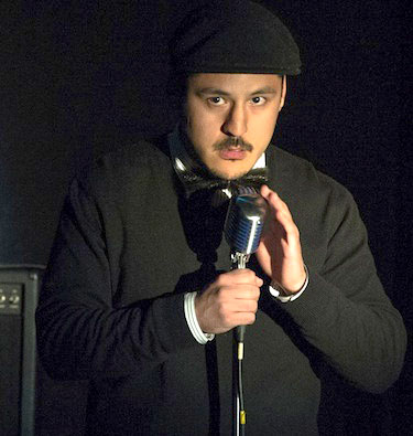 The late Nanauq Kusugak in 2013, entertaining an audience in Iqaluit at a Mahaha comedy night. The well-liked young man from Iqaluit died by suicide last week, prompting more calls for better mental health services in the territory. (FILE PHOTO)
