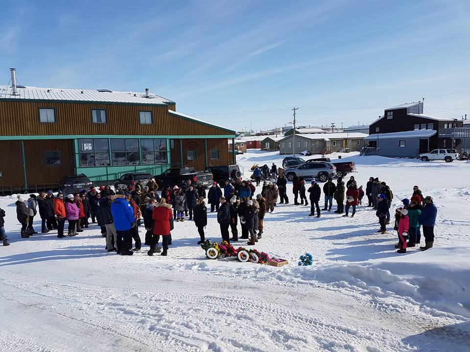 People in Kugluktuk are joined by family members and co-workers of an RCMP officer who died April 7 in an off-duty snowmobile mishap outside the western Nunavut community of Kugluktuk. (PHOTO COURTESY OF THE RCMP)