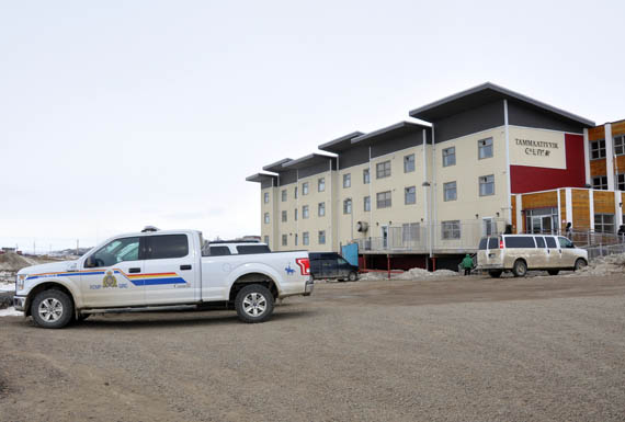 A Nunavut RCMP truck is parked outside the Tammaativvik boarding home in Iqaluit May 8, where a 22-year-old woman from Clyde River died by homicide on May 6. Her male domestic partner, 31, was also found dead. Police did not specify where they found his body, but said they are not seeking any suspects in the two deaths, which implies the man died by suicide. (PHOTO BY SARAH ROGERS)