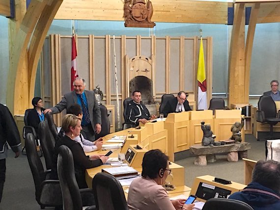Joe Savikataaq gets up to shake the hands of his fellow MLAs in the Nunavut legislature June 14, moments after learning that he would be Nunavut's fifth premier. (PHOTO BY BETH BROWN)