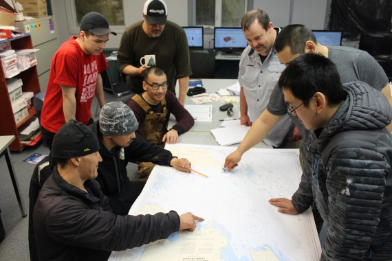 Franklin guardian trainees in Gjoa Haven huddle over marine charts during training this spring for their summer role of patrolling the Franklin shipwrecks. (PHOTO BY BARBARA OKPIK)