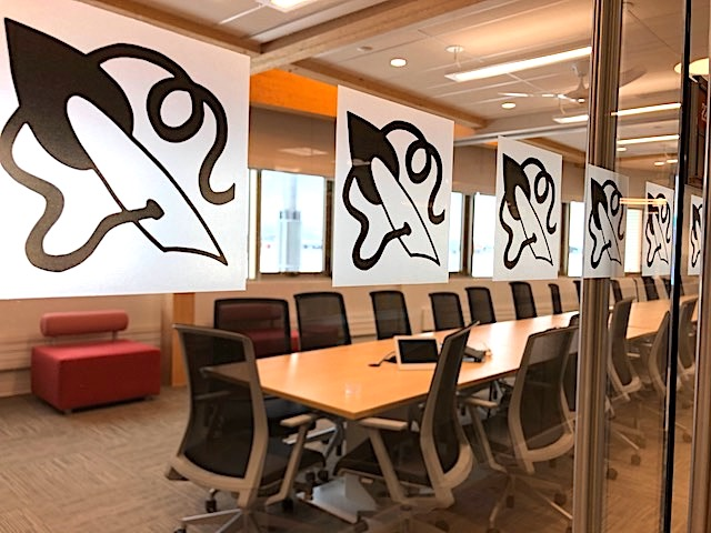"The main science building's board room features an extremely long table, which appears able to seat more than 20. On the window of the glass wall, you can see a design by Vicky Grey of Kangirsuk. For this and other artwork in the building, there were two pan-northern competitions on the theme ""Honouring the timeless creative genius of the Inuit."