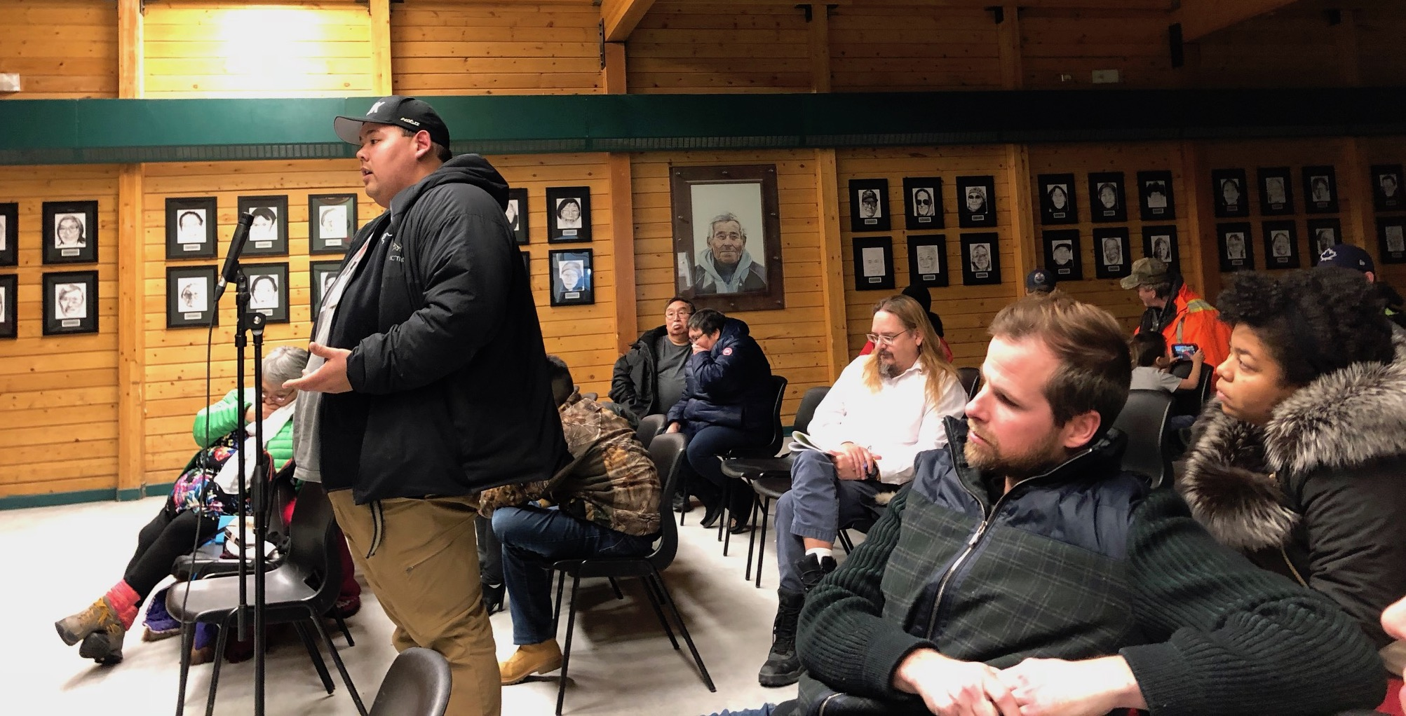 Compensation should be fair for Marine Transportation Services customers who won't see their trucks due to the company's barge cancellation, says Angut Pedersen of Cambridge Bay, who stood up on Oct. 15 in a public meeting for MTS customers in the Luke Novoligak Community Hall. (PHOTO BY JANE GEORGE)