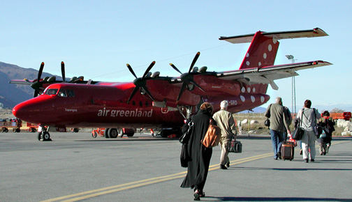 Passengers board an Air Greenland turboprop in Nuuk. The airline says it's looking at mid-September for meetings with the Government of Nunavut to discuss interest in a new route that would connect Iqaluit and Nuuk.