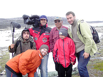 Lucassie Napaaluk and his grandson Peter, both of Kangiqsujuaq, stand with Greg Hemmings, bottom left, and the members of the film crew who visited their community in 2007 to produce a documentary for an Italian television network. (PHOTO COURTESY OF G. HEMMINGS)