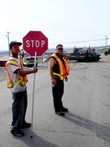 A road paver's dream: last weekend's dry heat in Iqaluit was perfect for the city's road paving team, who managed to  lay asphalt on most roads in the Happy Valley section of town. (PHOTO BY JANE GEORGE)
