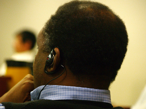 John Mabberi-Mudonyi, the City of Iqaluit's director of finance, listens to council proceedings through an earpiece Oct. 27, 2009. During that meeting, councillors voted to spend $75,000 on a new audio system for city hall's council chambers.