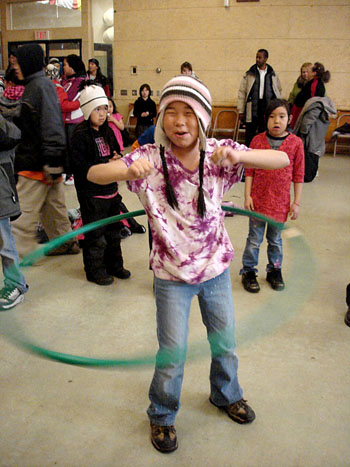 Students learned how to hula-hoop as part of an Oct. 22 pep rally to prepare for the arrival of the Olympic torch in Kugluktuk on Nov. 5. (PHOTO BY JANE GEORGE)