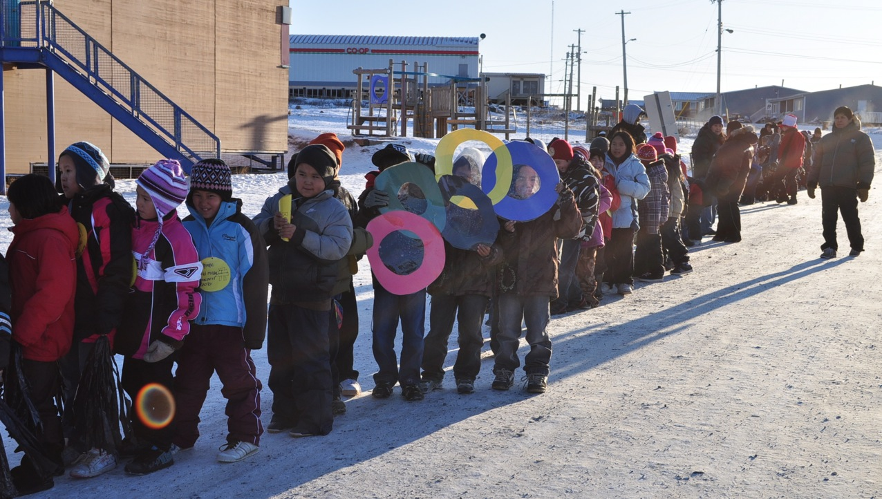Elementary school students in Kugluktuk carry hand-made Olympic logos as they head off to an Oct. 22 pep rally for the arrival of the Olympic torch relay on Nov. 5. (PHOTO BY VANESSA MOSEK)