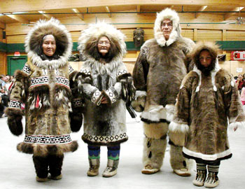 To wrap up nightly celebrations held during its annual general meeting, the Kitikmeot Inuit Association held a traditional fashion show Oct. 28 at the Luke Novoligak community centre. The winners from left to right: Kate Inuktalik of Kugluktuk, Susie Konana of Gjoa Haven, Wally Porter of Cambridge Bay and Pamela Emingak of Cambridge Bay.