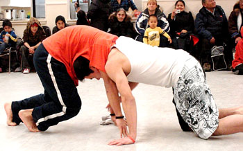 "Young athletes try out their hand at an Inuit game called ""muskox fight"" at the Luke Novoligak community centre in Cambridge Bay during nightly celebrations organized during the recent KIA annual general meeting."