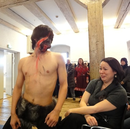 A bawdy East Greenlandic mask dancer flirts with a member of the audience during the Dec. 16 Inuit and Arctic Indigenous Peoples Day event at the North Atlantic House in Copenhagen. (PHOTO BY JANE GEORGE)