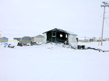 A Iqaluit man, Richard Doucet, 32, suffered severe injuries in a Feb. 19 fire that gutted this old matchbox house that's been converted into a shack on the beach. His 19-year-old girlfriend now faces one count of arson.