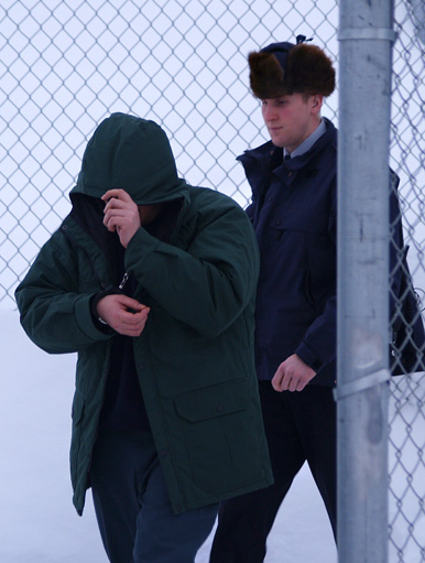 Pingoatuk Kolola is led out of the Nunavut Justice Centre in Iqaluit, Tuesday Feb. 23. Kolola is on trial for the first-degree murder of RCMP Const. Douglas Scott in Kimmirut in November, 2007. (PHOTO BY CHRIS WINDEYER)