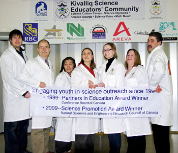 Kivalliq science teachers celebrate the NSERC award for science education at their regional science fair in Baker Lake. From left: Steve Penney (Whale Cove), Jim Kreuger (Baker Lake),  Angeline Simik (Chesterfield Inlet), Jeninith Peart (Baker Lake),  Jennifer Perry (Repulse Bay),  Katharine O'Connell (Rankin Inlet), Tony Phinney (Arviat). Missing from Photo: Bill Cooper (Baker Lake), Glen Brocklebank (Chesterfield Inlet), Danielle Fitzgerald (Arviat)