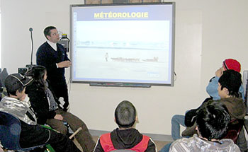 Environment Canada's Rene Heroux gives a lesson in meteorology to students in Ivujivik in January. (PHOTO COURTESY ENVIRONMENT CANADA)