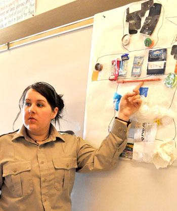 "This display of trash picked up around Kugluktuk offers Charlene Beanish, the Kitikmeot's environmental protection officer, a chance to tell young students about the ""three R's"" of energy conservation— that is, to reduce, reuse and recycle. (PHOTO BY VANESSA MOSEK)"