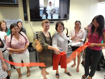 It's open! Solange Loiselle of the Kativik Regional Government and Annie Grenier of the Kativik School Board cut the red ribbon on June 22 to officially open the Ivirtivik Centre, a training centre for Inuit in Montreal. (PHOTO BY JANE GEORGE)