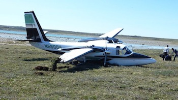 This 1971 Aero Commander 500S Aircraft en route from Oregon to Switzerland crash-landed shortly after take-off from Rankin Inlet's airport on July 18. All three passengers walked away, but their plane, shown here shortly after the crash, is a write-off.