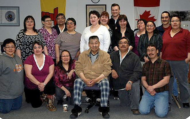 The Kitikmeot Inuit Association staff members are  mourning the loss of the organization's long-time executive director, Fred Elias— shown here sitting in the middle of the front row with the KIA staff— who died July 17 of cancer. (PHOTO COURTESY OF THE KIA)