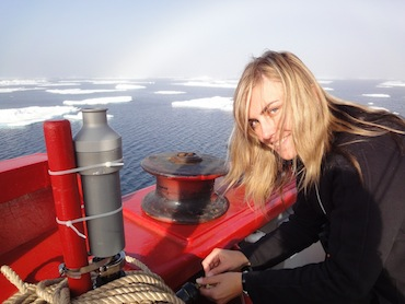 Researcher Anya Gawor attaches a cylinder to the deck of the Amundsen to take air samples which will show which pollutants have travelled to the Arctic from the south. (PHOTO BY JANE GEORGE)