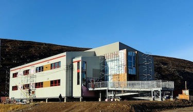Construction workers put the final touches on Kangiqsualujjuaq's new assisted living facility. The building should be open by early November. (PHOTO BY PASCAL POULIN)