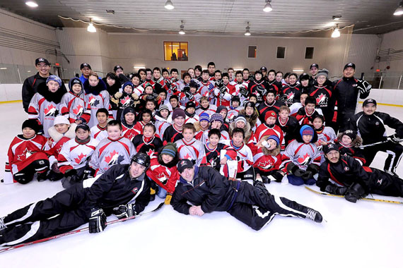 Kangiqsualujjuaq hockey players pose with instructors from Hockey Canada who visited Nunavik Jan. 22. (PHOTO BY PASCAL POULIN)