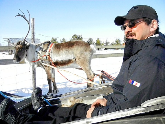 Ross Tatty of Rankin Inlet, the chair of the Kivalliq Regional Wildlife Federation, gets set to take a ride on reindeer sleigh March 29 during a visit  to the Kittilä district of northeastern Finland, where Agnico-Eagle Mines  operates a gold mine similar to their proposed Meliadine mine near Rankin Inlet. (PHOTO BY JIM BELL)