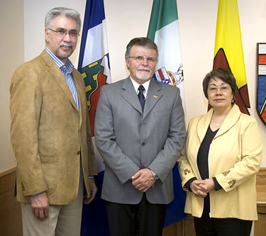 Northwest Territories Premier Floyd Roland, outgoing Yukon Premier Dennis Fentie and Nunavut Premier Eva Aariak pose for a photo during their 2010 meeting in Whitehorse. In Yellowknife this week, the three released two papers on territorial climate change adaptation and renewable energy. (FILE PHOTO)