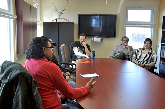 NDP candidate Romeo Saganash meets with staff at the Kativik Municipal Housing Bureau in Kuujjuaq April 27. (PHOTO BY SARAH ROGERS)
