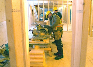 Workers inside one of the many 10-plex units built throughout Nunavut under the Nunavut Housing Trust social housing construction program. (FILE PHOTO)