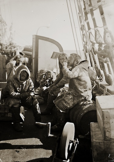 Here Roald Amundsen shares a meal with Netsilingmiut friends on the deck of the Gjoa. (PHOTO COURTESY OF THE FRAM MUSEUM)