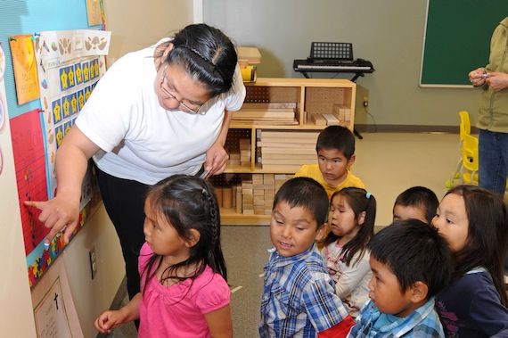 Ina Baron, kindergarten teacher at Kangiqsualujjuaq's Ulluriaq School, introduces her new students to school on Aug. 29. (PHOTO BY PASCAL POULIN)