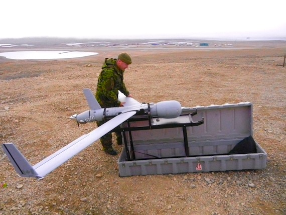 Master Bombardier Stephen O'Brien explains the operations of the Unmanned Aerial Vehicle, which was parked on a hill overlooking the Resolute Bay airport during Operation Nanook. (PHOTO BY JANE GEORGE)