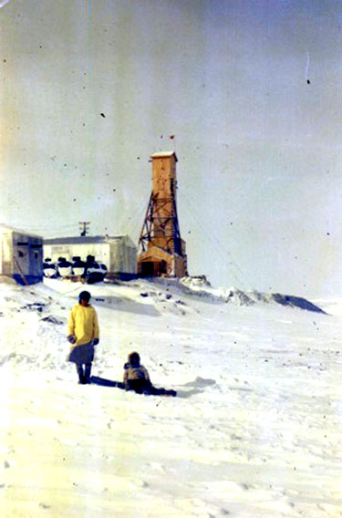 This photo of an Inuit woman and child was taken in front of the North Rankin Nickel Mine the year it opened, in 1957. (GN Archives)