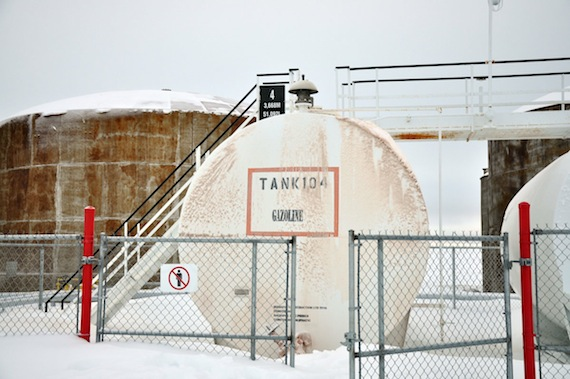 Resolute Bay's fuel tank farm, where crews have contained almost 100,000 litres of spilled fuel since last week. The smaller white tank in the foreground draws fuel from the largest tanks and is used to distribute fuel to the public. But sometime late Oct.27, the valves to that tank were opened and fuel spilled out from the bell-like feature at the top of the tank. The spill went unnoticed until early Oct. 28, when RCMP were called to investigate. (PHOTO COURTESY OF RON ELLIOTT)