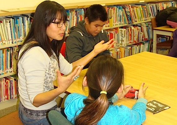 CyberWolf and former aboriginal role model Inez Jasper speaks last week with Jaanimmarik students Elijah Sequaluk and Harriet Koneak as the school launched its CyberWolf program. The CyberWolves program is an online group mentoring program for First Nations, Métis and Inuit students in Grades 7 and 8. CyberWolves first meet the students they will continue to mentor online during weekly sessions. During those periods, they'll discuss such subjects as education, careers, culture and community. Increasing academic achievement and encouraging healthy lifestyles are among the CyberWolves' goals. (PHOTO COURTESY OF JAANIMMARIK SCHOOL)