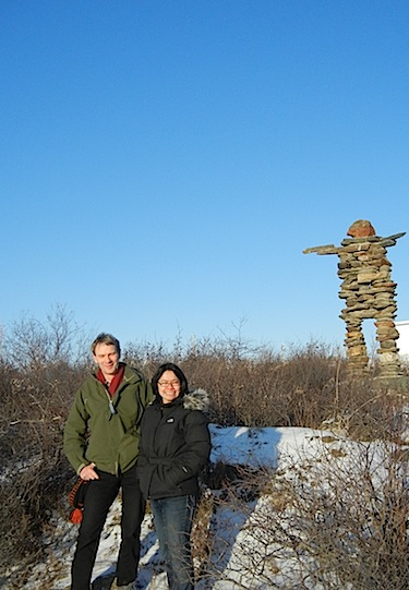 Thierry Rodon, a Laval university professor who also teaches a Carleton University course at Nunavut Sivuniksavut, and Madeleine Redfern, mayor of Iqaluit, stand by Kuujjuaq's landmark inuksuk Nov. 23. Rodon led a workshop Nov. 22 on Improving access to university education in the Canadian Arctic. The workshop's participants included Redfern who says northern studies need to be taught in the North. (PHOTO BY JANE GEORGE)
