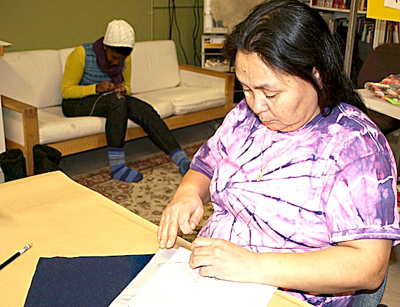 Susan Enuaraq embroiders an image she created as part of the Healing Through Art gathering held Nov. 26 in the Nunavut Arctic College fine arts building in Iqaluit. A similar session, scheduled for Dec. 3, from  2 p.m. to 6 p.m., is open to anyone who wishes to commemorate the loss of a loved one through art. The art created will be displayed as part of the annual National Day of Action and Remembrance on Violence Against Women ceremony Dec. 6 at Inuksuk High School. (PHOTO BY DEAN MORRISON)