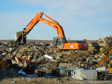 Heavy equipment was moving trash around all summer at the Cambridge Bay landfill — part of its $5.4-million makeover. (PHOTO BY JANE GEORGE)