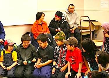 Kids play games at Ilisaqsivik's Dec. 15 Christmas Party in Clyde River. (PHOTO BY JORDAN NATANINE, COURTESY OF ILISAQSIVIK)