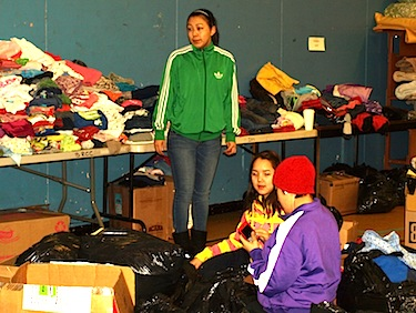 Volunteers help sort clothing Feb. 28 at Nunavut Arctic College's Ukkivik residence for victims of the Feb. 26 fire in Iqaluit. (PHOTO BY DEAN MORRISON)