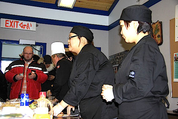 Fundraising for the 83 left homeless by Feb. 26 fire at Creekside Village in Iqaluit continues. Earlier this week, Cambridge Bay chef Andy Poisson and students in his Nunavut Arctic College culinary arts course cooked and served up a lunch to raise money. People who want to help support Red Cross relief efforts underway are encouraged to contribute by calling 1-800-418-1111 or visiting the Canadian Red Cross website for the fire relief effort at www.redcross.ca/iqaluitfire2012. Several fundraising events in Iqaluit are planned for March 3, including a Loonie-Toonie sale at Iqaluit's Anglican Parish Hall from 10 a.m. to 4 p.m., a bake sale from noon to 3 p.m. at the Arctic College main campus, and a show featuring Iqaluit musicians at the Royal Canadian Legion from 8:30 p.m. to 11:30 p.m. (PHOTO BY RED SUN PRODUCTIONS)