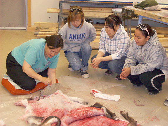 Retired teacher Sarah Takolik often returns to school to make Inuktitut materials for the Department of Education and to share her knowledge with students. She is pictured here with Anna Wolki, Gail Poodlat and Junette Kingmeaqtuq. (FILE PHOTO)