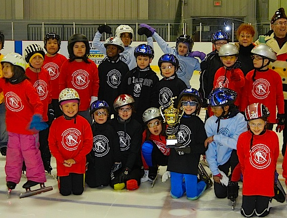 Students from Iqaluit's elementary schools pose on the ice at the Arctic Winter Games arena on March 31 with the new John Sands Iqaluit Inter-school champion cup, sponsored by Sands, a former 1956 and 1960 Olympic speed skater. The event saw participants, some of whom had never speed-skated before, competing on the ice. (PHOTO BY JANE GEORGE)