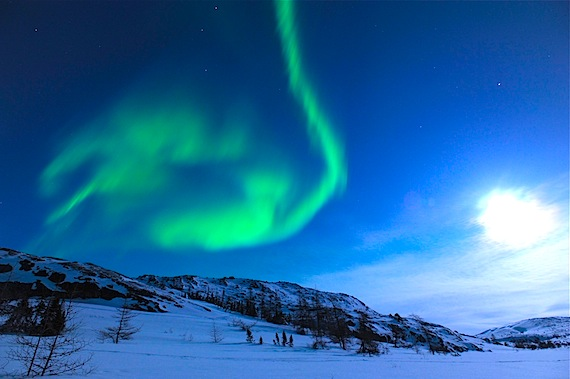 A powerful solar storm of magnetically-charged particles, which hit the Earth March 8, did not disrupt power grids or satellite communications as some feared. But it did, as forecast, produce a display of bright green northern lights, like this one near the Nunavik community of Kangiqsualujjuaq on Thursday evening. In the right of the photo, the moon, nearly full, also lit up the sky. (PHOTO BY PASCAL POULIN)